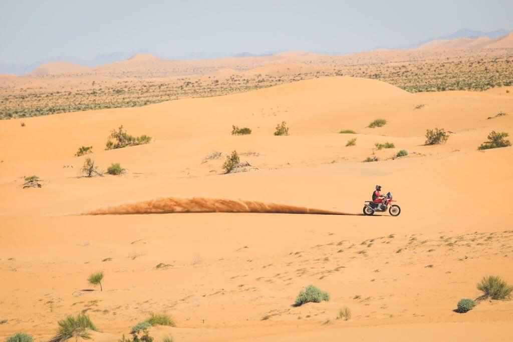 Sonora Rally Raid Motorcycle driving across a dune