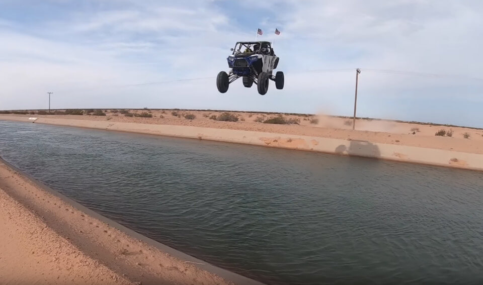 ruslans_greasehandz_ten_year_old_jumps_glamis_canal_in_utv