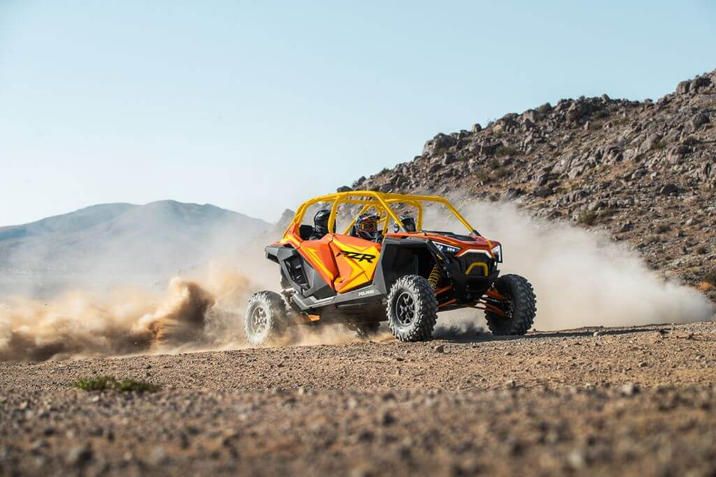 Polaris RZR PRO XP Orange Madness Seater driving in the desert